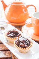 Tea time with crispy chocolate tarts