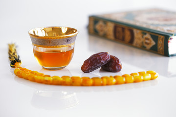 Masbaha, Quran, Arabic tea and dried dates symbol Ramadan