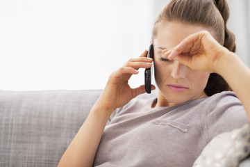 Frustrated young woman talking cell phone