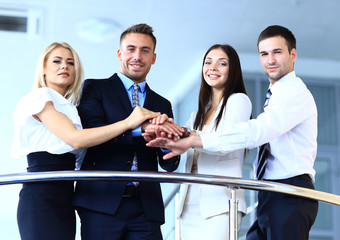 Portrait of positive business group standing on stairs