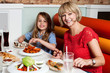 Mother and daughter enjoying meal together