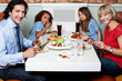 Cheerful family enjoying dinner