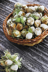 Green hazelnuts in a basket