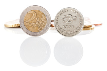 2 Euro coin next to 2 kuna coin - Croatian currency
