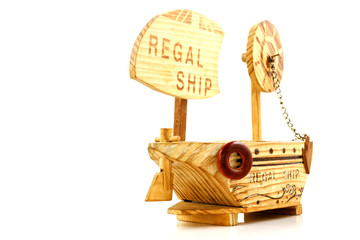 Wooden ship toy model, isolated on white background