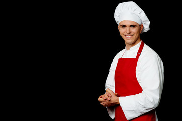 Isolated male chef over black background