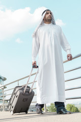 Business trip. Full length of Arab businessman with suitcase