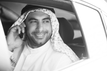 Cheerful Arab businessman. Black and white image of smiling Arab