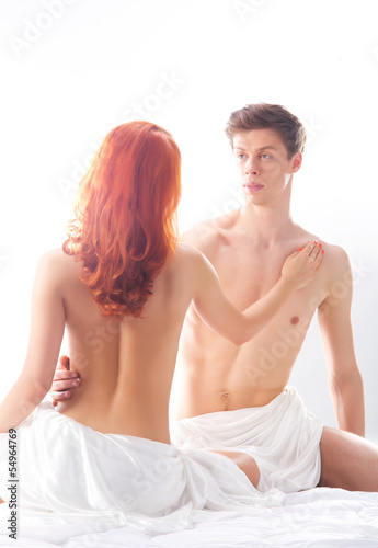 A lovely Caucasian couple posing naked in the bed