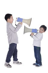 Two children yell at megaphone