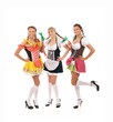 Three young and happy women in Bavarian clothes