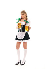 A young blond bavarian woman posing with glasses of beer