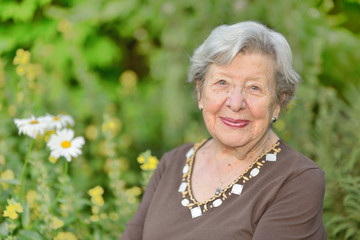 Friendly Looking Senior Woman in Her Garden 1