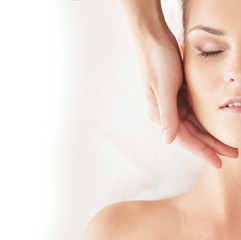 Portrait of a young woman relaxing on a head massage procedure