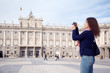 Young woman photographs palace of Spanish kings in Madrid