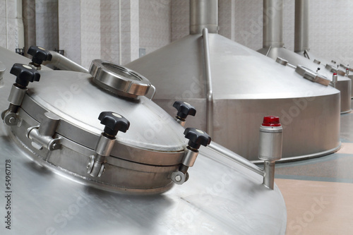 Big metal cisterns for beer in  factory