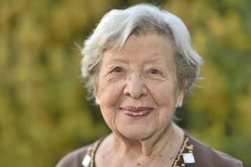 Friendly Looking Senior Woman in Her Garden 2