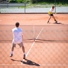 male tennis match competition on sand court