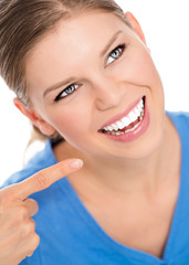 Happy woman portrait showing white healthy teeth, isolated