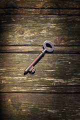 Old key on wood boards