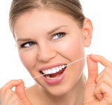 Dental hygiene woman cleaning teeth with floss, isolated