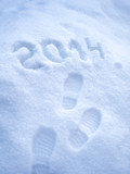 Foot step prints in snow, New Year 2014 concept