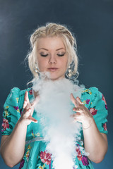 The young blonde holds hands above a smoke