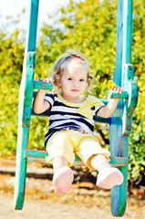 swinging toddler