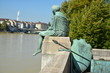 Sitting Helvetia statue on the river Rhine in Basel, Switzerland