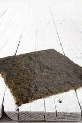 A sheet of dried seaweed on a white table