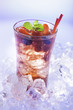 cold refreshment with .berries, mint and soda on ice cubes.