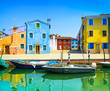 Venice landmark, Burano canal, houses and boats, Italy