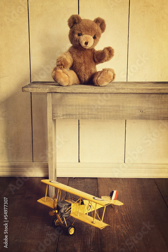 Antique toys on wooden bench with vintage look