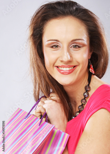 woman happy holding shopping bags.
