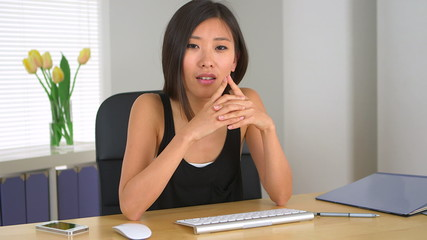 Chinese businesswoman talking to colleague