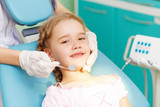 Little girl visiting dentist - 54980973