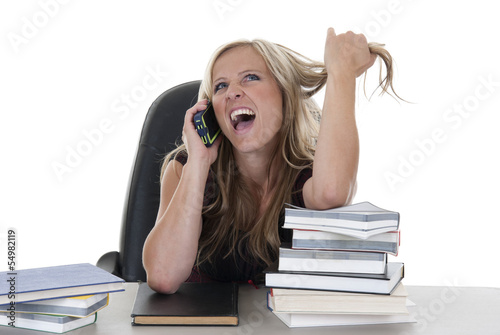 Attractive woman talking on cellphone neglecting homework