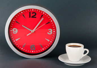 Cup coffee and clock on gray background