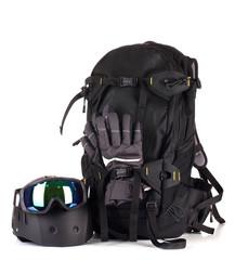 Winter sport glasses, helmet and gloves, backpack, isolated
