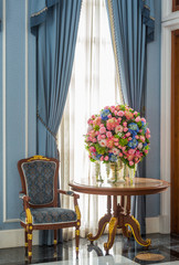 Elegance armchair and flower bouquet on table