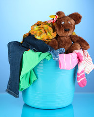 Laundry basket on blue background