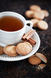 Homemade cookies with cinnamon and a cup of tea, selective focus