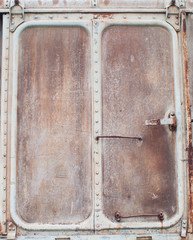 Very old iron door with rusty details