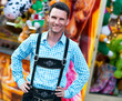 Young man wearing traditional Bavarian Lederhosen