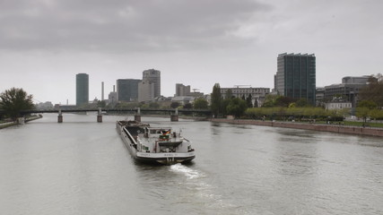 Barge going down Main river in Frankfurt
