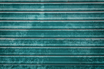 closed teal roller door background