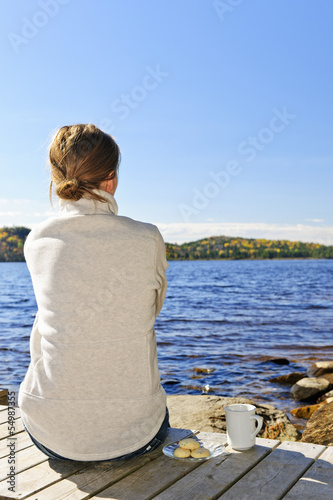 Woman relaxing at lake shore