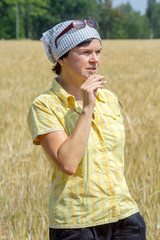 Organic farmer examines their corn field