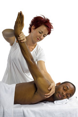 young female therapist helping young male patient