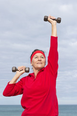 Happy healthy mature woman exercising